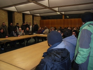 After a cold day on the market, traders pack into meeting with local MP.